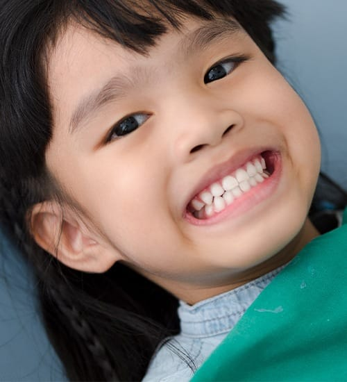 Child smiling after silver diamine fluoride treatment