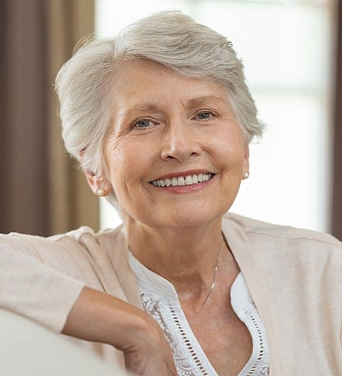 Older woman with dentures smiling