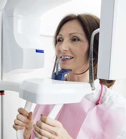 Woman receiving C T cone beam scanner
