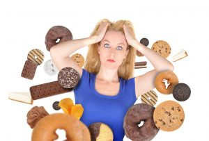 Woman battling sugary foods.