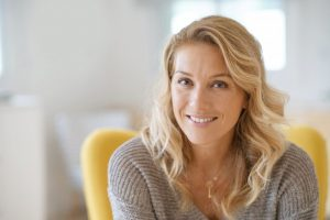 Woman smiling after learning more about American Heart Month